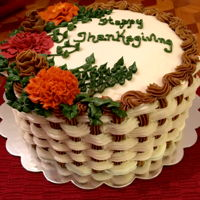 Thanksgiving Carrot Cake Three layer carrot cake frosted and decorated with cream cheese frosting.
