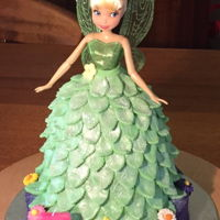 Tinker-Belle Birthday Cake For 3 Year Old. Tinker-bell doll sunk into a Dolly Varden cake on top of a purple base cake. This base cake was marble and the Dolly Varden was chocolate...