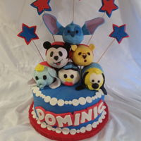 Tsum Tsum Gang Vanilla cake with buttercream frosting covered in marshmallow frosting. Tsum Tsum gang - Mickey Mouse, Winnie the Pooh, Stitch, Donald Duck...