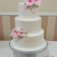 Wedding Cake Three tiered wedding cake decorated with sugar lace and gumpaste pink roses