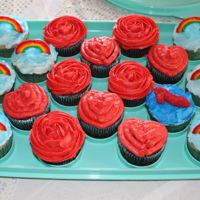 Wizard Of Oz   buttercream frosting, heart-shape cupcakes, chocolate rainbows, flowers on the smash cake were purchased