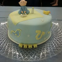 Baby Boy Shower Cake Baby boy shower cake. Yellow cake covered in pale blue fondant with a butt-flat and buttons to look like a onesie and various baby decals (...
