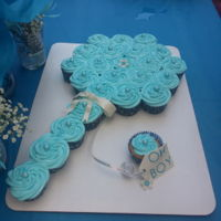 Baby Shower Pull-Apart Rattle Cake Pull apart rattle cupcakes, vanilla with chocolate ganache filling and fluffy blue frosting topped with sparkling sanding sugar and...