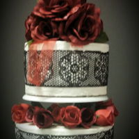 "Black & Red Stunner Chocolate sugarveil covers the sides of this ""Coming of Age"" cake"""