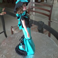 Bob Mackie Inspired Barbie Made Out Of Satin Ice Gum Paste   Beautiful Bob Mackie inspired Barbie wearing turquoise and black gown.