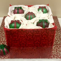 Box Of Christmas Ornaments  All edible. Ornaments made from white chocolate. Fondant box and paper. Royal icing for stenciled box and board. Chocolate peppermint cake...