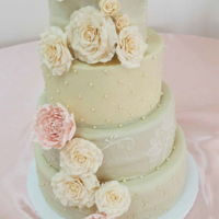 Champagne, Blush, & Ivory Wedding A 4 Tier wedding cake with cascading sugar roses