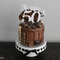Chocolate Drip Cake  Chocolate drip cake for a 50th birthday! Chocolate cake with vanilla buttercream filling sprinkled with toffee bits and drizzle with...