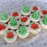 Christmas Cupcakes eggnog-nutmeg cake, vanilla ABC, piped trees and poinsettias, sprinkled with sugar crystals and non-pareils
