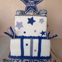 "Dallas Cowboy Cake   This is a 10"" and 8"" square cake. Frosted in Buttercream icing. Trimmed in fondant. 5 Cakepops on top."