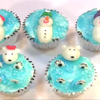Floating Snowmen And Polar Bears Cupcakes I made the snowmen and polar bears out of Airheads candy. Wanted to try something other than fondant. Then did an arctic water effect on...