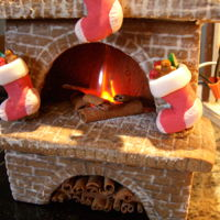Gingerbread House - Christmas Bakery This years gingerbread house is a Christmas Bakery complete with a gingerbread working fireplace! To see more details and a video go to...