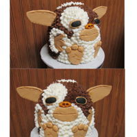Gizmo Cake Vanilla cake with strawberry filling. All buttercream with fondant features.