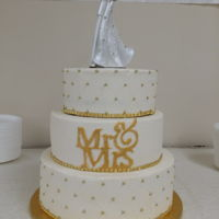 Golden Wedding Gold accents highlight this all buttercream covered cake