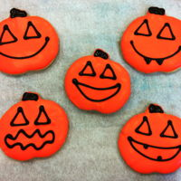 Jack O Lantern Cookies   Jack o lantern cookies for Halloween! Sugar cookies, dipped in white chocolate with dark chocolate faces piped on. TFL!
