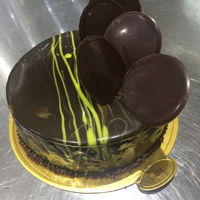 Mirror Glaze This is a mango honey comb chocolate cake and homemade chocolate decorations