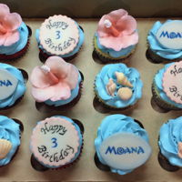 Moana Birthday Cupcakes A mix of Red Velvet and Classic Vanilla Cupcakes with Vanilla Buttercream. Marshmallow Fondant Shells, Hibiscus Flowers, & hand painted...