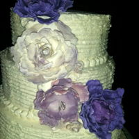 Peony Wedding Cake Varies shades of purple peonies cover this buttercream beauty.