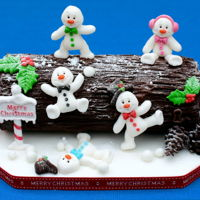 Rocky Road Yule Log A rocky road Christmas log covered in chocolate with fondant decorations