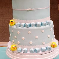 Rubber Ducky Baby Shower Cake   Baby shower cake with fondant rubber ducks and baby blocks