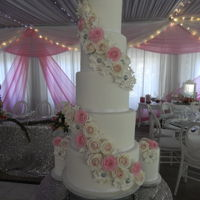 Ruffles And Roses 5 tier ice white wedding cake with rose pink and blush pink sugar roses