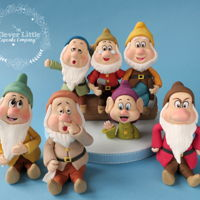 Seven Dwarfs Fondant Figures Made for a customer making her own cake.