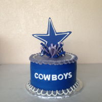 "Small Dallas Cowboys Cake   8"" round. Frosted in buttercream. Trimmed in fondant. I made the cake for my husbands birthday."