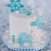 Snowflakes! Christmas cake for a friend. Six inch chocolate fudge cake with dark chocolate buttercream filling, covered with fondant and then sprinkled...