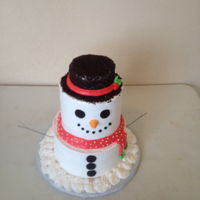 "Snowman This is an 8"", 6"" and 4"" round Snowman cake. It is frosted completely in whip cream. Hat is covered in oreos. The arms are..."