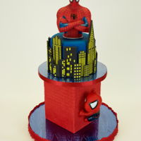 Spider-Man Birthday Cake Cake for a Spider-Man fan. Only the top tier is cake - chocolate fudge cake with dark chocolate buttercream filling, covered with fondant....