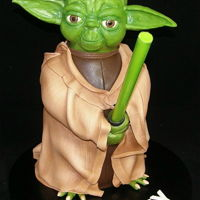 Yoda Star Wars Cake  This cake was made for Bailey, who is turning 5 and is a big Star Wars fan. His mum wanted a standing 3D Yoda for the cake design and this...