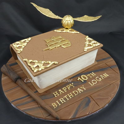 Harry Potter Book Cake  This is the cake I made for my son Logan's10th birthday this weekend.25cm white chocolate mud cake with allfondant decorations with...