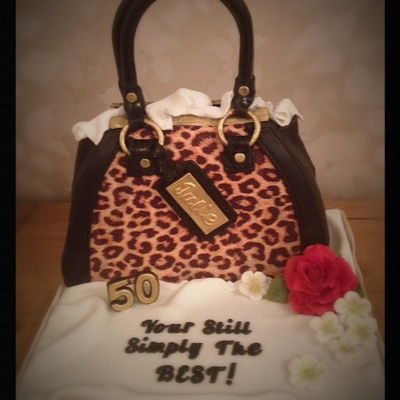 Leopard Print Handbag Cake   this cake was for someone who loves handbags, leopard print, red roses and a line from her favorite song!!
