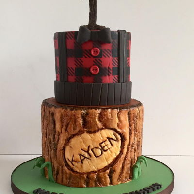"Lumber Jack 1St Birthday  cake: 7"",5"" rounds orginal design by Shannon Bond bottom tier made using tree bark mold and hand painting, top tier pattern..."