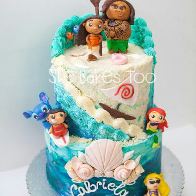 Moana And Company   This is a 3 layer 10in + 8in buttercream cake with fondant accents and rtk figurines. Can you see Nemo and Dory hiding?