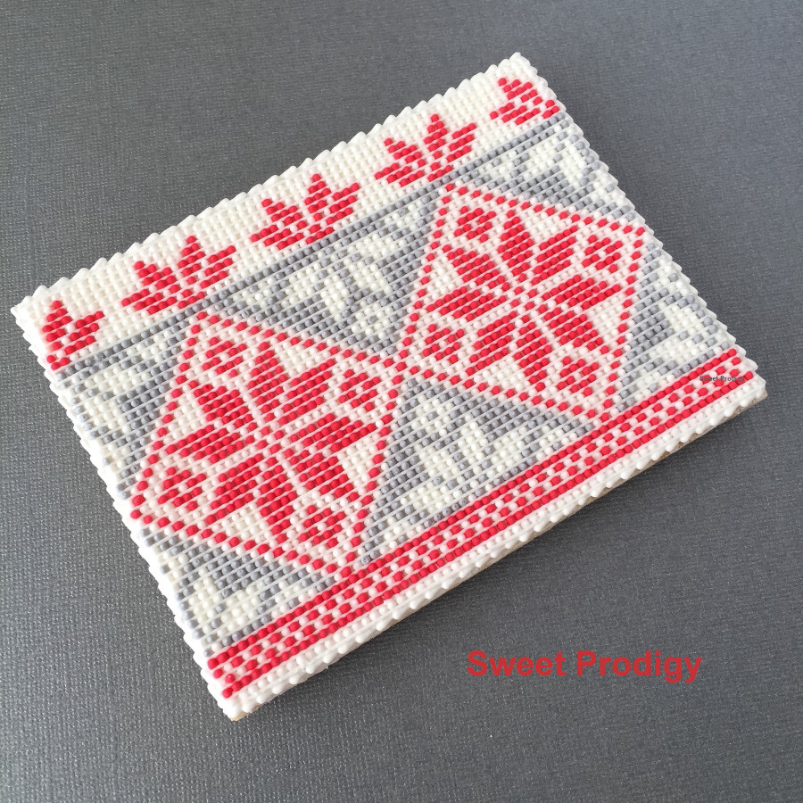 Winter Sweater | Sweet Prodigy This sugar cookie is decorated with royal icing needlepoint. The pattern reminds me of a warm, cozy sweater on a cold winter day.