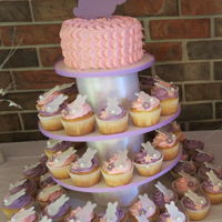 1St Birthday Bunny Cake First Birthday Bunny Cupcake Tower. Pink and Purple cupcakes with white fondant bunnies and flowers with a buttercream pulled dot smash...