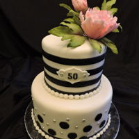 50Th Birthday Peony Cake   9- and 6-inch round covered in fondant with black and silver accents. The Pink Peony on top is gumpaste.