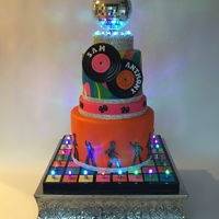 70's Themed Birthday Cake A 70's Themed birthday cake for a Husband and Wife sharing the same Birthday. The light worked and the Disco Ball rotated.