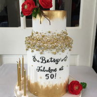 Betsy's Fabulous 50Th brushed gold and lots and lots of dragees. Handmade sugar ranunculus.