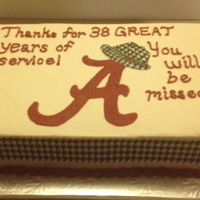 Alabama Crimson Tide Retirement Cake This is a vanilla cake with buttercream icing, edible image houndstooth on the sides and hand painted Bear Bryant hat.