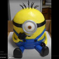 Baby Minion 4 six inch layers of white cake covered in MMF.