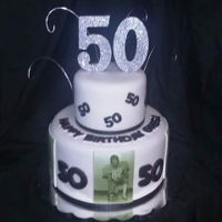 Black & White 50Th Birthday Cake Part chocolate, part white chocolate. Fondant with edible images from each decade of life