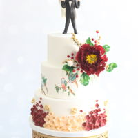 Burgundy Resplendence Latest cake a friend and I worked on for the wedding of a famous Squash player in India. I worked on the cake, painting, details, flowers,...
