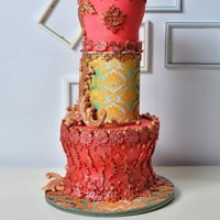 Cake Chocolate cake with baroque elements in the color gold and fuchisia