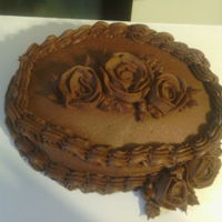 Chocolate Cake With Chocolate Bc Icing And Roses Chocolate cake with chocolate bc icing and roses.