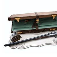 Choko Cake hunting rifle and suitcase in real size
