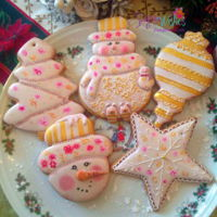 Christmas In Gold And Pink. Snowmen , stars , Xmas tree gingerbread.