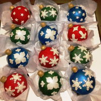 Christmas Ornament Cupcakes 2016 Vanilla cupcakes and half balls held together and covered with cream cheese buttercream, covered with tinted Satin ice and white Satin Ice...