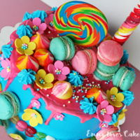 Colourful Drip Cake Drip cake with macarons, lollipop and candy